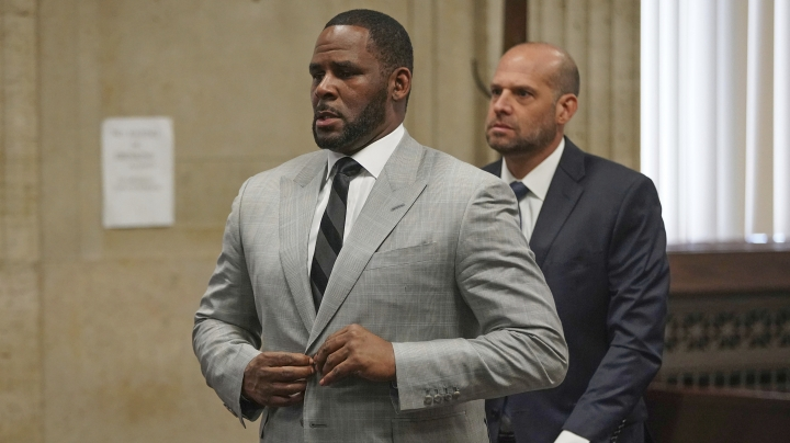 FILE - In this June 6, 2019, file photo, singer R. Kelly pleaded not guilty to 11 additional sex-related felonies during a court hearing before Judge Lawrence Flood at Leighton Criminal Court Building in Chicago. Kelly, who was arrested in Chicago on July 11, 2019 on a federal grand jury indictment listing 13 counts including sex crimes and obstruction of justice, was ordered held without bond on Tuesday, July 16. (E. Jason Wambsgans/Chicago Tribune via AP, Pool)