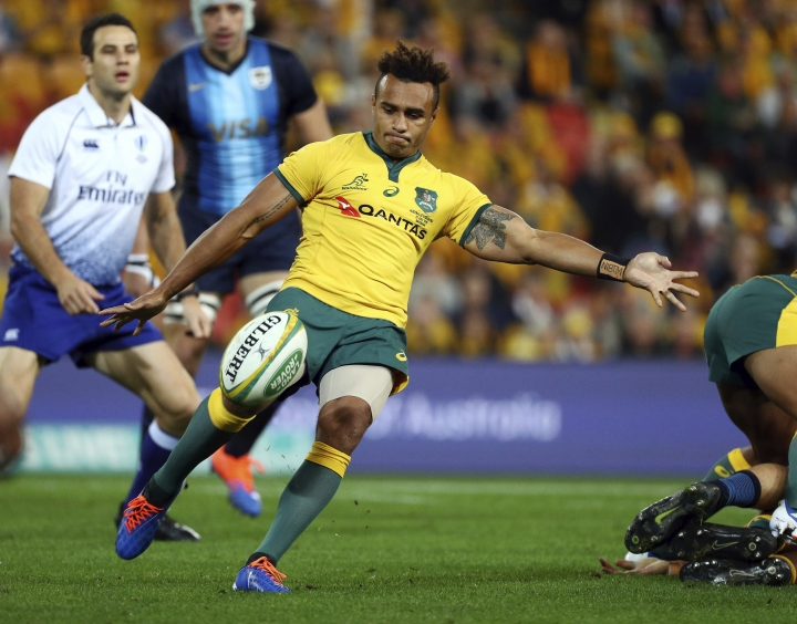 Australia's Will Genia kicks the ball during a Rugby Championship match between Australia and Argentina in Brisbane, Australia, Saturday, July 27, 2019. (AP Photo/Tertius Pickard)