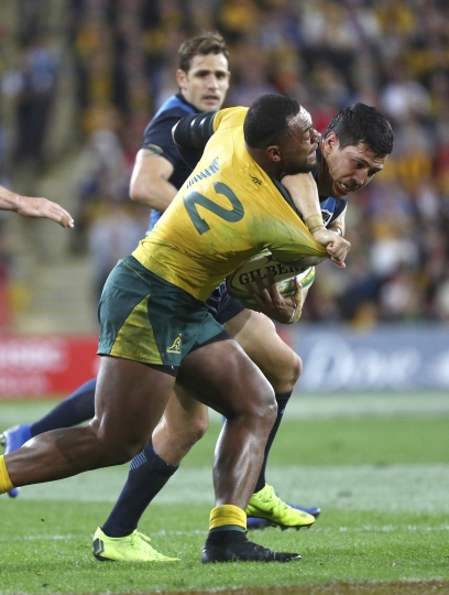 Argentina's Matias Moroni, right, is tackled by Australia's Samu Kerevi, left, during the Rugby Championship match between Australia and Argentina in Brisbane, Australia, Saturday July 27, 2019. (AP Photo/Tertius Pickard)