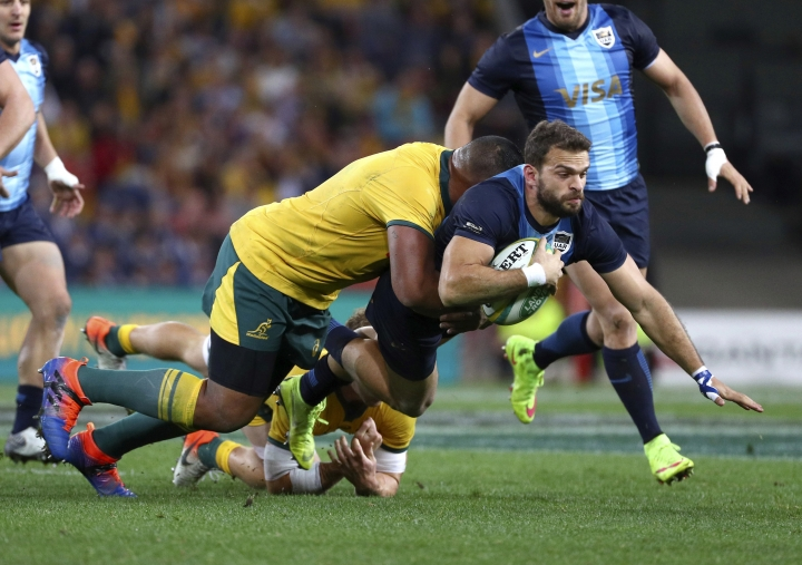 Argentina's Ramiro Moyano, right, is tackled by Australia's Sekope Kepu, left, during a Rugby Championship match between Australia and Argentina in Brisbane, Australia, Saturday, July 27, 2019. (AP Photo/Tertius Pickard)