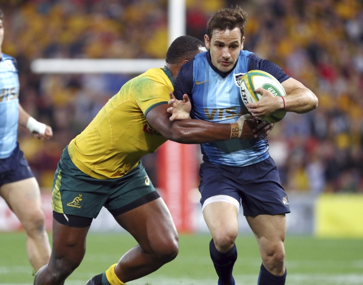 Argentina's Nicolas Sanchez, right, is tackled during a Rugby Championship match between Australia and Argentina in Brisbane, Australia, Saturday, July 27, 2019. (AP Photo/Tertius Pickard)