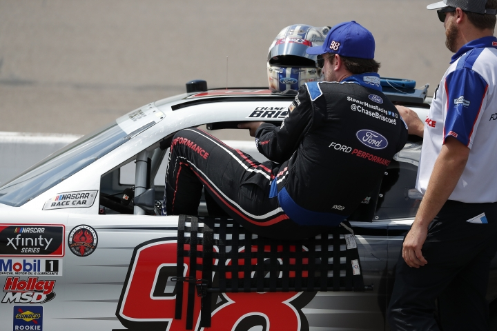 Chase Briscoe climbs into his car during qualifying for the NASCAR Xfinity Series auto race, Saturday, July 27, 2019, at Iowa Speedway in Newton, Iowa. (AP Photo/Matthew Putney)