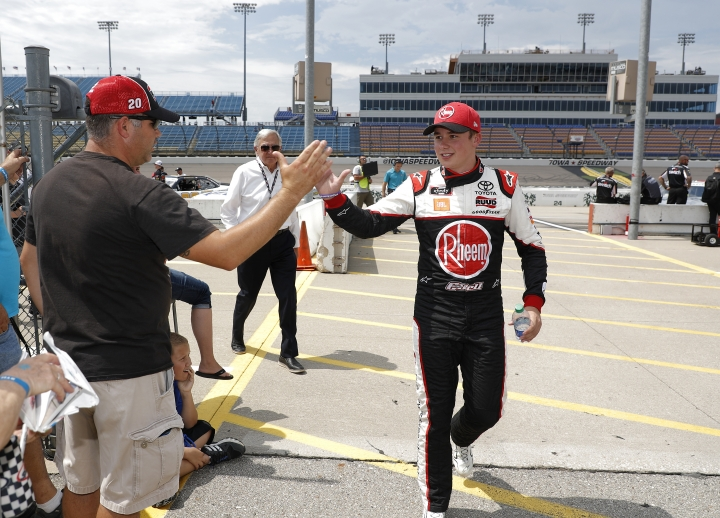 Christopher Bell high fives fans after winning the pole during qualifying for the NASCAR Xfinity Series auto race, Saturday, July 27, 2019, at Iowa Speedway in Newton, Iowa. (AP Photo/Matthew Putney)