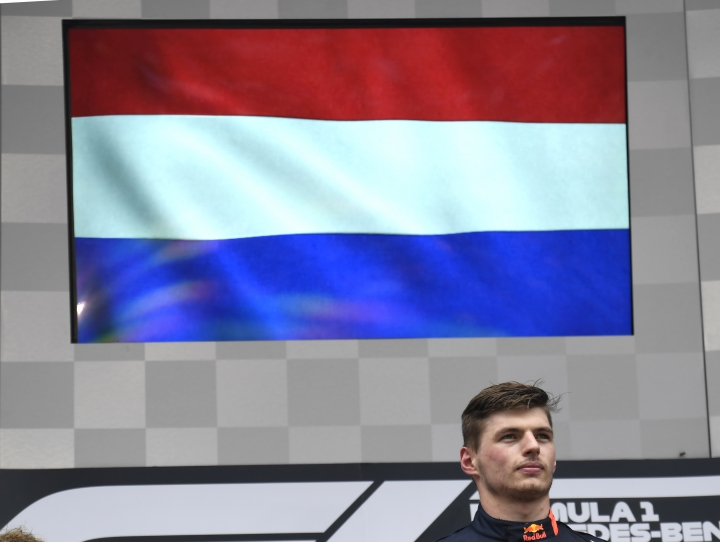 Red Bull driver Max Verstappen of the Netherland's stands on the podium during the Dutch national anthem after he won the German Formula One Grand Prix at the Hockenheimring racetrack in Hockenheim, Germany, Sunday, July 28, 2019. (AP Photo/Jens Meyer)