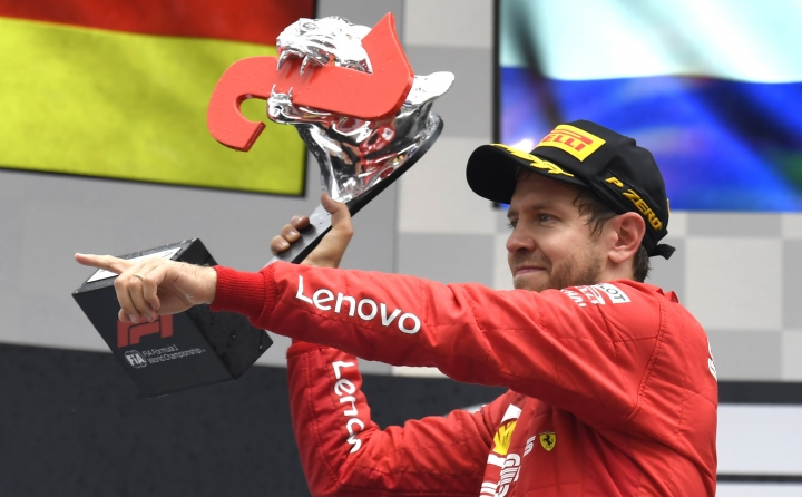 Ferrari driver Sebastian Vettel of Germany celebrates on the podium after he placed second in the German Formula One Grand Prix at the Hockenheimring racetrack in Hockenheim, Germany, Sunday, July 28, 2019. (AP Photo/Jens Meyer)