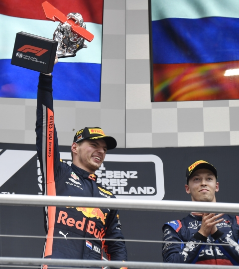 Red Bull driver Max Verstappen of the Netherland's, left, celebrates on the podium after he won the German Formula One Grand Prix at the Hockenheimring racetrack in Hockenheim, Germany, Sunday, July 28, 2019. On the right is third place Toro Rosso driver Daniil Kvyat of Russia. (AP Photo/Jens Meyer)