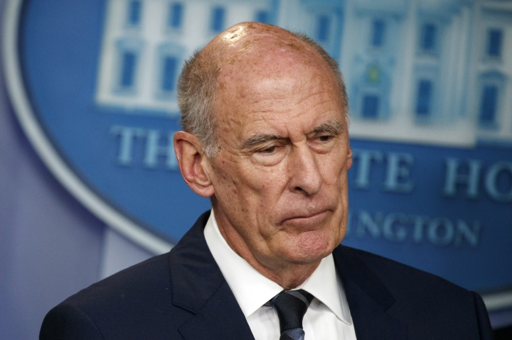 FILE - In this Aug. 2, 2018, file photo, Director of National Intelligence Dan Coats listens during a daily press briefing at the White House in Washington. Coats is to resign in days, after a two-year tenure marked by President Donald Trump's clashes with intelligence officials, U.S. officials said on Sunday, July 28, 2019. (AP Photo/Evan Vucci, FIle)