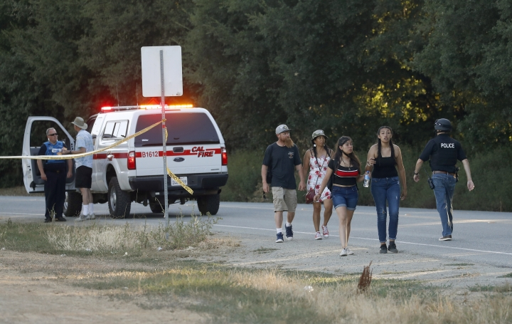 People leave the Gilroy Garlic Festival following a deadly shooting in Gilroy, Calif., on Sunday, July 28, 2019. (Nhat V. Meyer/San Jose Mercury News via AP)