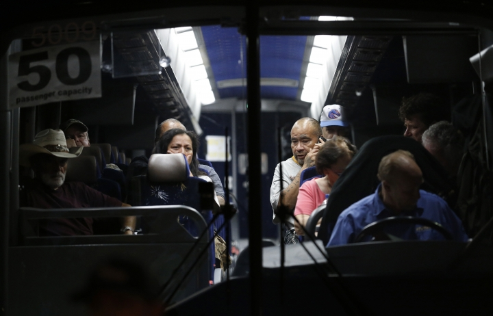 Festival attendees are transported on a bus following a shooting at the Gilroy Garlic Festival, in Gilroy, Calif., Sunday, July 28, 2018. (AP Photo/Josie Lepe)