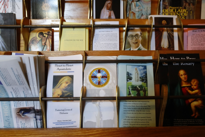 Informational pamphlets for Opus Bono Sacerdotii are displayed with others at The Assumption of the Blessed Virgin Mary Church in Detroit, Friday, June 7, 2019. For nearly two decades, the small nonprofit organization called Opus Bono Sacerdotii, operating out of a series of unmarked buildings in rural Michigan, has provided money, shelter, transport, legal help and other support to priests accused of sexual abuse. (AP Photo/Paul Sancya)