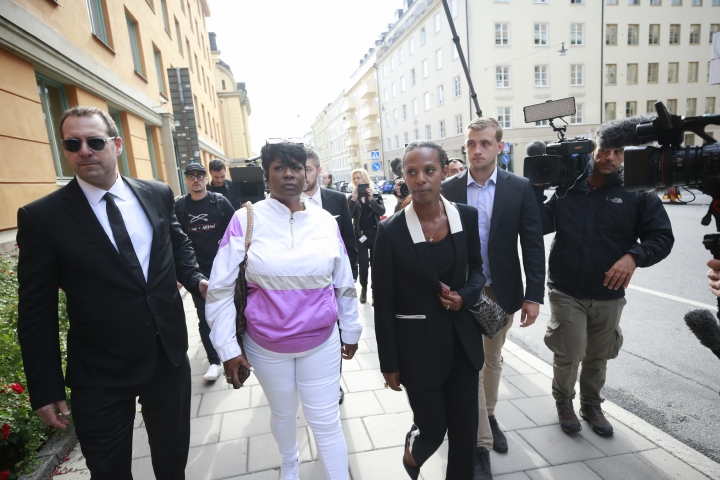 Renee Black, 2nd left, ASAP Rocky's mother, arrives to the district court where US rapper A$AP Rocky is to appear on charges of assault, in Stockholm, Sweden, Tuesday July 30, 2019. American rapper A$AP Rocky and two other men believed to be members of his entourage are going on trial Tuesday in Sweden in a high-profile legal case that has caught the attention of U.S. President Donald Trump and rallied music and entertainment celebrities among others. (Fredrik Persson / TT via AP)