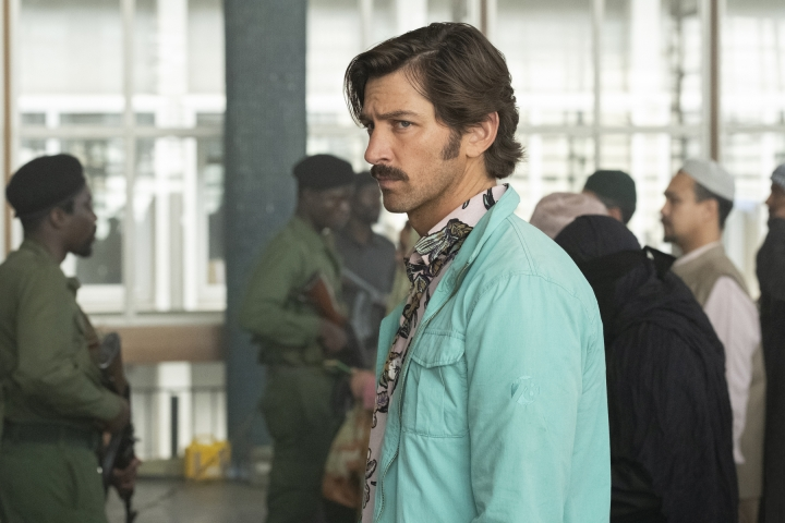"""This image released by Netflix shows Michiel Huisman in a scene from """"The Red Sea Diving Resort."""" (Marcos Cruz/Netflix via AP)"""
