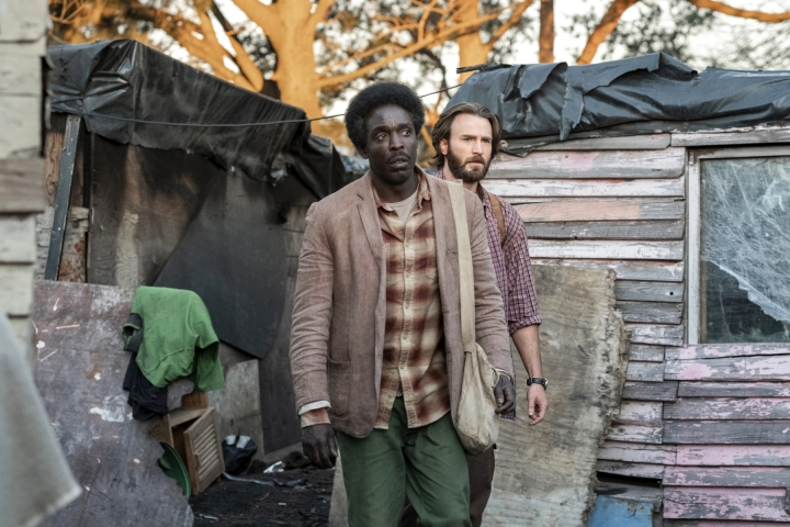 "This image released by Netflix shows Michael Kenneth Williams, foreground, and Chris Evans in a scene from ""The Red Sea Diving Resort."" (Marcos Cruz/Netflix via AP)"