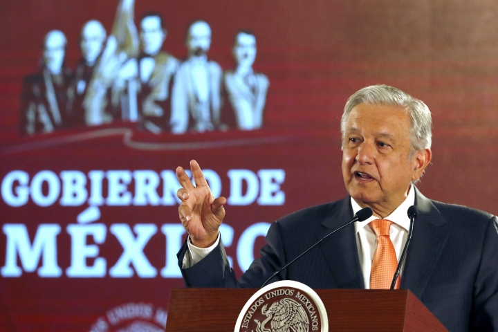 FILE - In this April 9, 2019 file photo, Mexican President Andres Manuel Lopez Obrador speaks during a signing ceremony in an agreement with the United Nations High Commissioner for Human Rights, at the National Palace in Mexico City. Mexican officials said Monday, July 22, 2019, they have uncovered an industrial-scale migrant smuggling ring using tractor-trailer rigs disguised as freight deliveries for major companies. Lopez Obrador said authorities found a tractor-trailer disguised with the logo of a major grocery store chain. But instead of groceries, it was carrying about 150 migrants. (AP Photo/Marco Ugarte, File)