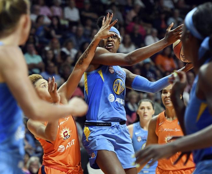 Connecticut Sun guard Natisha Hiedeman fouls Chicago Sky guard Diamond DeShields during a WNBA basketball game Tuesday, July 30, 2019, in Uncasville, Conn. (Sean D. Elliot/The Day via AP)