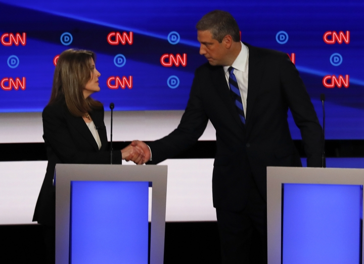 Marianne Williamson and Rep. Tim Ryan, D-Ohio, shake hands after the first of two Democratic presidential primary debates hosted by CNN Tuesday, July 30, 2019, in the Fox Theatre in Detroit. (AP Photo/Paul Sancya)