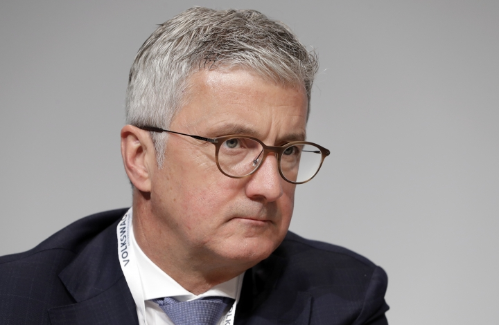 FILE - In this Thursday, May 3, 2018 file photo, Rupert Stadler, then CEO of Audi AG, attends the shareholders' meeting of the Volkswagen stock company in Berlin, Germany. German prosecutors announced Wednesday July 31, 2019, that they have charged Rupert Stadler and three other individuals with fraud in connection with sales of diesel cars with software that enabled cheating on emissions tests. (AP Photo/Michael Sohn, FILE)