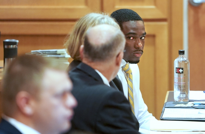 In this Tuesday, July 30, 2019 photo, former University of Wisconsin football player Quintez Cephus, right, watches during his sexual assault trial at the Dane County Courthouse in Madison, Wis. The 21-year-old Cephus is charged with second- and third-degree sexual assault after two 18-year-old women reported to police that he had assaulted them on the same night in April 2018. (Steve Apps/Wisconsin State Journal via AP)