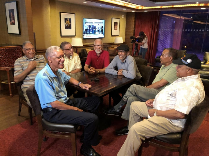 """Seven Davis brothers - Eddie, Frederick, Arguster, Octavious, Nathaniel, Julius and Lebronze chat during a reunion at a hotel-casino on Friday, July 12, 2019 in Tunica, Miss. In 2017, the Davis men were honored by the National Infantry Museum Foundation. The foundation's president calls their combined military record """"nothing short of remarkable."""" (AP Photo/Adrian Sainz)"""
