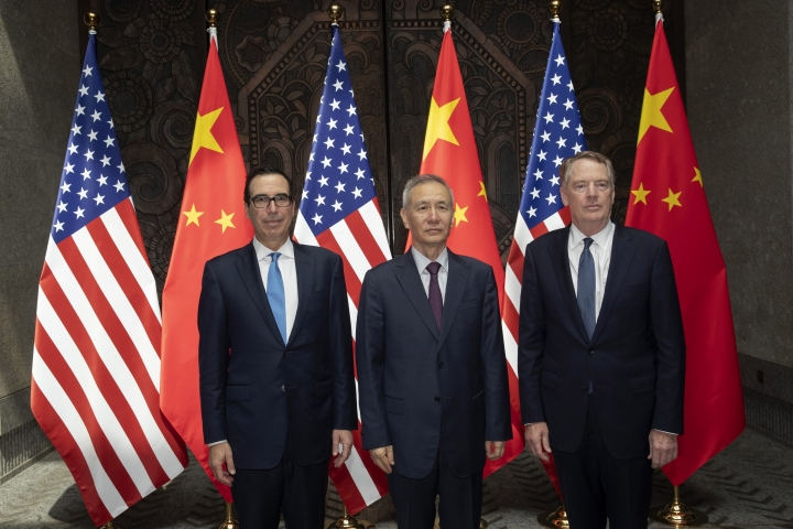 CORRECTS SPELLING TO STEVEN INSTEAD OF STEVE - Chinese Vice Premier Liu He, center, poses with U.S. Trade Representative Robert Lighthizer, right, and Treasury Secretary Steven Mnuchin pose for photos before holding talks at the Xijiao Conference Center in Shanghai Wednesday, July 31, 2019. (AP Photo/Ng Han Guan, Pool)