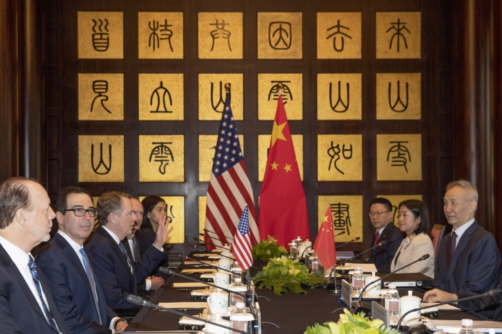 CORRECTS SPELLING TO STEVEN INSTEAD OF STEVE - Chinese Vice Premier Liu He, right, looks over as U.S. Trade Representative Robert Lighthizer, third from left, gestures near Treasury Secretary Steven Mnuchin, second from left, before the start of talks at the Xijiao Conference Center in Shanghai Wednesday, July 31, 2019. (AP Photo/Ng Han Guan, Pool)