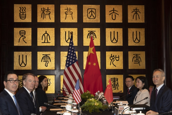 CORRECTS SPELLING TO STEVEN INSTEAD OF STEVE - Chinese Vice Premier Liu He, right, sits with U.S. Trade Representative Robert Lighthizer, second from left, and Treasury Secretary Steven Mnuchin, left, before the start of talks at the Xijiao Conference Center in Shanghai Wednesday, July 31, 2019. (AP Photo/Ng Han Guan, Pool)