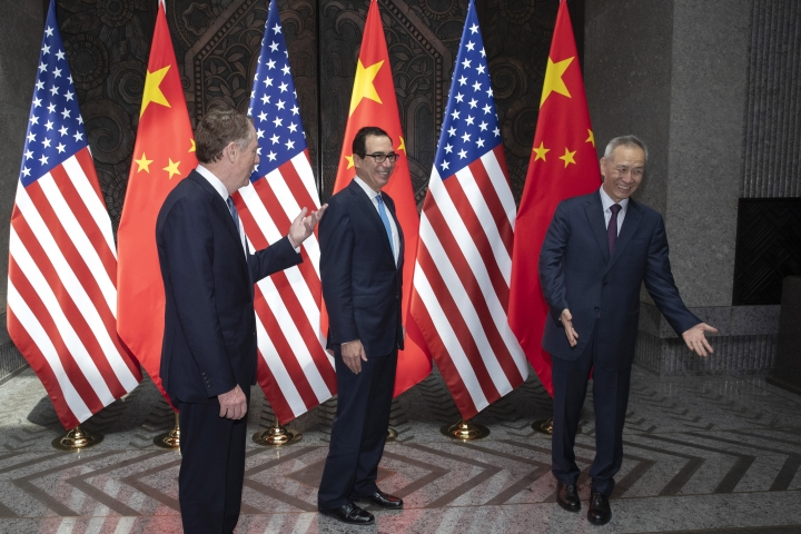 CORRECTS SPELLING TO STEVEN INSTEAD OF STEVE - Chinese Vice Premier Liu He, right, welcomes U.S. Trade Representative Robert Lighthizer, left, and Treasury Secretary Steve, Mnuchin, center before holding talks at the Xijiao Conference Center in Shanghai Wednesday, July 31, 2019. (AP Photo/Ng Han Guan, Pool)