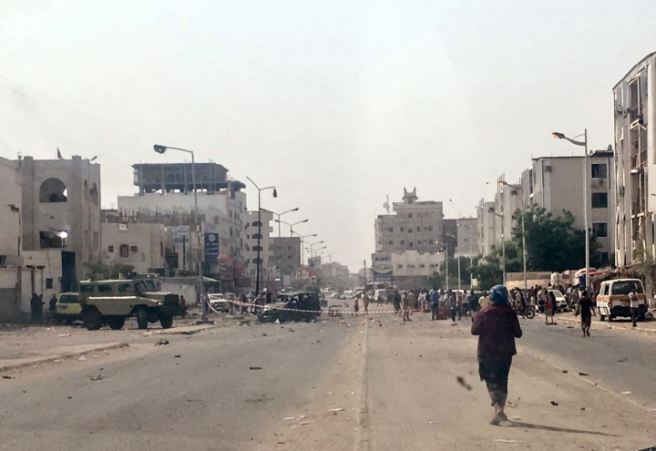 Security forces gather at the site of a deadly attack in Aden, Yemen, Thursday, Aug. 1, 2019. A Yemen health official and witnesses say at least 40 people have been killed and dozens wounded in a missile attack and coordinated suicide bombings in the southern port city of Aden. The official says the missile struck a military parade underway Thursday in Aden, the temporary seat of the U.N. recognized Yemeni government. (AP Photo/Nariman El-Mofty)