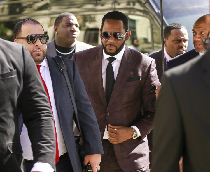 "FILE - In this June 26, 2019, file photo, R&B singer R. Kelly, center, arrives at the Leighton Criminal Court building for an arraignment on sex-related felonies in Chicago. Lifetime announced Tuesday, July 23, that it has ordered ""Surviving R. Kelly: The Aftermath,"" a four-part series interviewing new survivors and experts. (AP Photo/Amr Alfiky, File)"