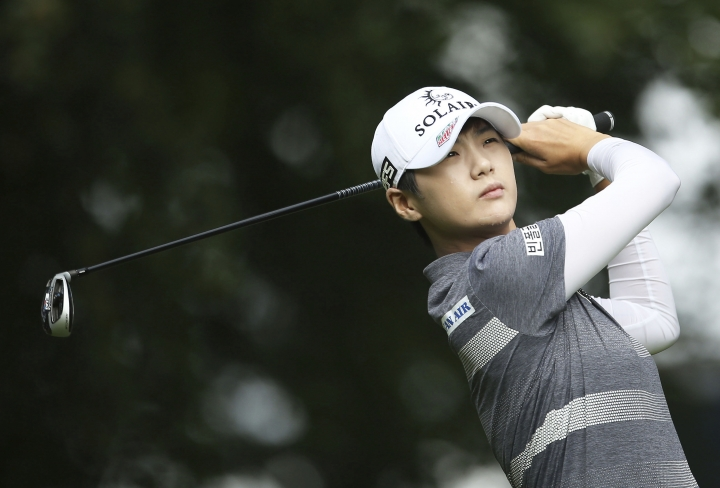 South Korea's Park Sung-hyun plays off the 12th tee on day one of the AIG Women's British Open at Woburn Golf Club, Little Brickhill, England, Thursday Aug. 1, 2019. (Steven Paston/PA via AP)
