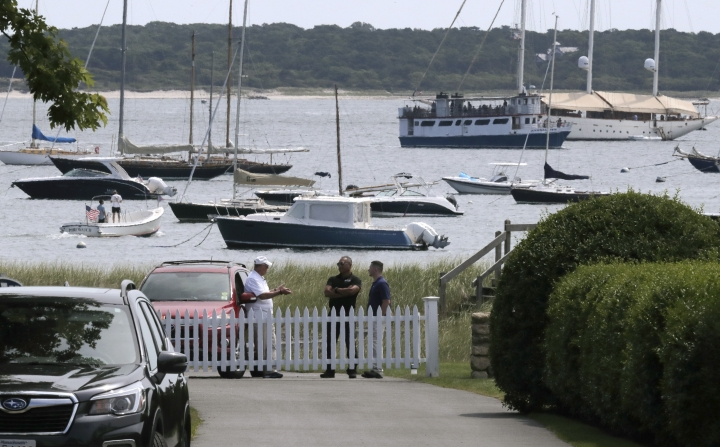 People stand inside the Kennedy compound on Friday, Aug. 2, 2019, in Hyannis Port, Mass. Saoirse Kennedy Hill, granddaughter of Ethel Kennedy and her late husband Robert F. Kennedy, died at the compound on Thursday. She was 22. (AP Photo/Charles Krupa)