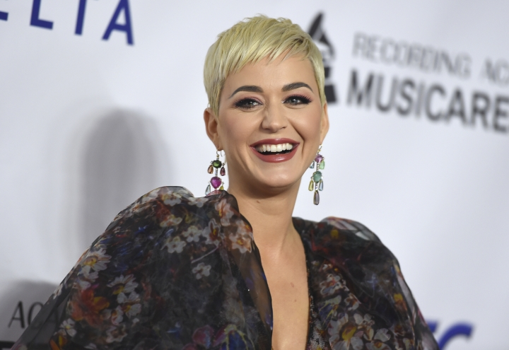 "FILE - In this Feb. 8, 2018 file photo, Katy Perry arrives at MusiCares Person of the Year honoring Dolly Parton at the Los Angeles Convention Center. A Christian rapper who won a nearly $3 million judgement over Perry's hit ""Dark Horse"" used his song's millions of plays on YouTube and Spotify as evidence that Perry and her team may have heard it and then stole it. The Perry trial that ended Thursday, Aug. 1, 2019, with a win for rapper Marcus Gray showed that streaming services and other technology may be proving challenging for copyright law. (Photo by Jordan Strauss/Invision/AP, File)"