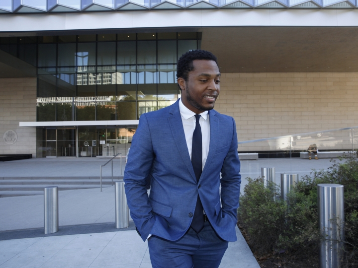 "Rapper Marcus Gray leaves the federal courthouse in Los Angeles, Thursday, Aug. 1, 2019. A jury has decided that Katy Perry, her collaborators and her record label must pay more than $2.78 million because the pop star's 2013 hit ""Dark Horse"" copied a Christian rap song. It was an underdog victory for relatively obscure artist Gray, whose 5-year-old lawsuit survived constant court challenges. Perry's attorney said they plan to vigorously fight the decision. (AP Photo/Damian Dovarganes)"