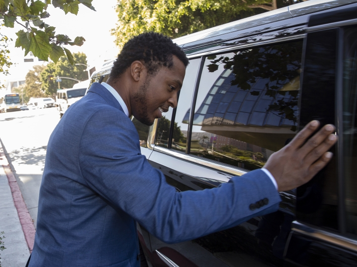 "Rapper Marcus Gray avoids talking to the media as he rushes into a waiting SUV, outside the federal courthouse in Los Angeles, Thursday, Aug. 1, 2019. A jury has decided that Katy Perry, her collaborators and her record label must pay more than $2.78 million because the pop star's 2013 hit ""Dark Horse"" copied a Christian rap song. It was an underdog victory for relatively obscure artist Gray, whose 5-year-old lawsuit survived constant court challenges. Perry's attorney said they plan to vigorously fight the decision. (AP Photo/Damian Dovarganes)"