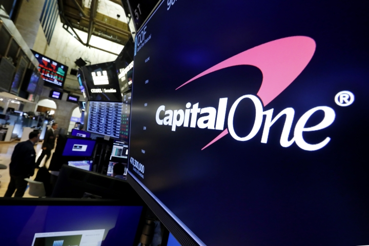 FILE - In this Tuesday, July 30, 2019, file photo, the logo for Capital One Financial appears above a trading post on the floor of the New York Stock Exchange. Data breaches through hacking attacks are common these days, and personal details about you can lead to identity theft, such as credit cards and loans in your name. Yet few victims can ever pin the blame on any specific breach, whether that's Equifax from 2017 or the recently disclosed breach at Capital One. (AP Photo/Richard Drew, File)