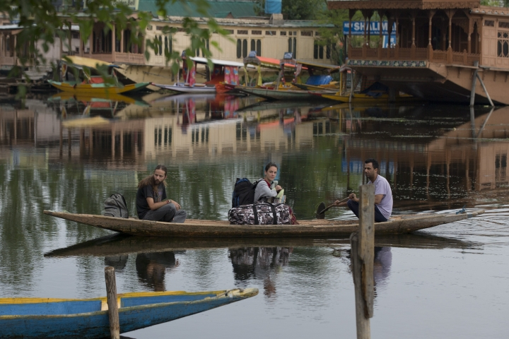 "Foreign tourist cross the Dal Lake on a shikara as they prepare to leave Srinagar, Indian controlled Kashmir, Saturday, Aug. 3, 2019. A government order in Indian-administered Kashmir on Friday asked tourists and Hindu pilgrims visiting a Himalayan cave shrine ""to curtail their stay"" in the disputed territory, citing security concerns and intensifying tensions following India's announcement it was sending more troops to the region. (AP Photo/ Dar Yasin)"