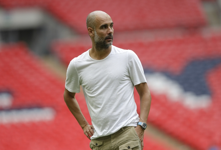 Manchester City's manager Pep Guardiola walks on the pitch after the English Community Shield soccer match between Liverpool and Manchester City at Wembley stadium in London, Sunday, Aug. 4, 2019. (AP Photo/Kirsty Wigglesworth)