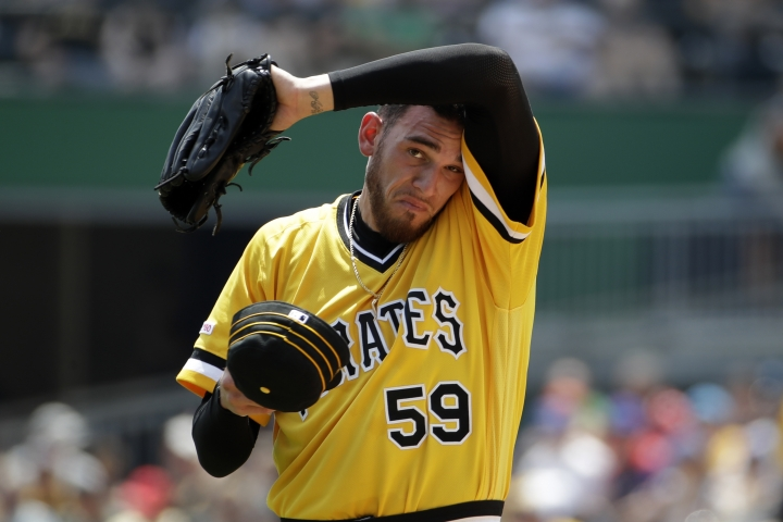 Pittsburgh Pirates starting pitcher Joe Musgrove wipes his head after giving up a two-run home run during the first inning of a baseball game against the New York Mets in Pittsburgh, Sunday, Aug. 4, 2019. (AP Photo/Gene J. Puskar)