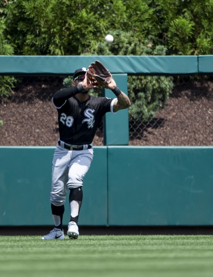 Chicago White Sox center fielder Leury Garcia catches a fly ball hit by Philadelphia Phillies' Jean Segura during the first inning of a baseball game, Sunday, Aug. 4, 2019, in Philadelphia. (AP Photo/Laurence Kesterson)