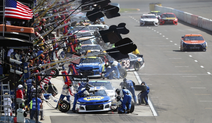 Eventual winner Chase Elliott makes a pit stop during a NASCAR Cup Series auto race at Watkins Glen International, Sunday, Aug. 4, 2019, in Watkins Glen, N.Y. (AP Photo/John Munson)