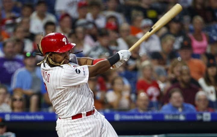 Philadelphia Phillies' Maikel Franco hits an RBI ground ball to score J.T. Realmuto during the fourth inning of a baseball game against the San Francisco Giants, Tuesday, July 30, 2019, in Philadelphia. (AP Photo/Chris Szagola)