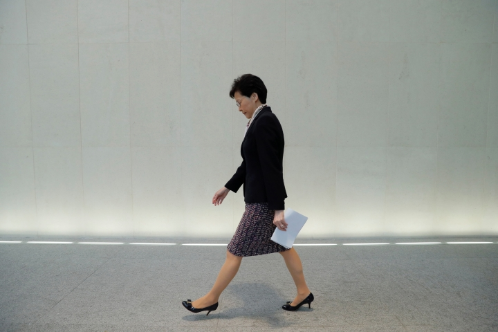 """Hong Kong's Chief Executive Carrie Lam walks to a press conference in Hong Kong Monday, Aug. 5, 2019. Lam said recent protests have pushed the city to the """"verge of a very dangerous situation"""" but the government will be resolute in ensuring public order. (AP Photo/Kin Cheung)"""