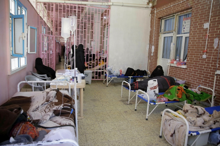 FILE - In this March 30, 2019 file photo, women are treated for suspected cholera infection at Al-Sabeen hospital, in Sanaa, Yemen. An Associated Press investigation found some of the United Nations aid workers sent in to Yemen amid a humanitarian crisis caused by five years of civil war have been accused of enriching themselves from an outpouring of donated food, medicine and money. Documents from an internal probe of the U.N.'s World Health Organization uncovered allegations of large funds deposited in staffers' personal bank accounts, suspicious contracts, and tons of donated medicine diverted or unaccounted for. (AP Photo/Hani Mohammed, File)