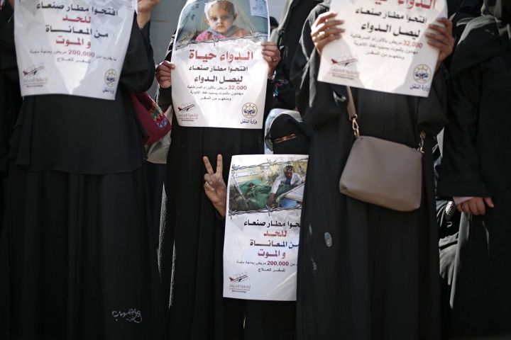 "FILE - In this Dec. 10, 2018 file photo, Yemeni women hold banners in Arabic that read, in part, ""Open Sanaa airport to limit the suffering and deaths,"" ""Medicine is life,"" and Open Sanaa airport to receive medical aide,"" as they take part in a protest calling for the reopening of the airport in Sanaa to receive medical aid, in front of the U.N. offices in Sanaa, Yemen. An Associated Press investigation found some of the United Nations aid workers sent in to Yemen amid a humanitarian crisis caused by five years of civil war have been accused of enriching themselves from an outpouring of donated food, medicine and money. (AP Photo/Hani Mohammed, File)"