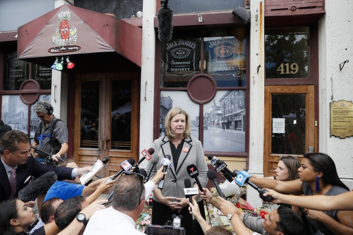 Dayton, Ohio, Mayor Nan Whaley speaks to members of the media Tuesday, Aug. 6, 2019, outside Ned Peppers bar in the Oregon District after a mass shooting that occurred early Sunday morning in Dayton. (AP Photo/John Minchillo)
