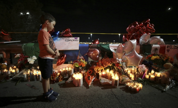 A boy reacts as he looks at teddy bears left for children killed, during a vigil Monday, Aug. 5, 2019, outside the Walmart in El Paso, Texas, where a mass shooting took place on Saturday. (Mark Lambie/The El Paso Times via AP)