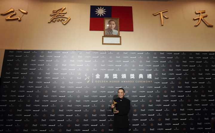 FILE - In this Nov. 17, 2018, file photo, Chinese director Zhang Yimou holds his award for Best Director at the 55th Golden Horse Awards in Taipei, Taiwan. China said Wednesday, Aug. 7, 2019, that it was banning Chinese movies and actors from participating in Taiwan's Golden Horse Awards, one of the Asian film industry's most prestigious honors, as Beijing continues efforts to bring economic and political pressure to bear on the island it claims as its own territory. (AP Photo/Billy Dai, File)