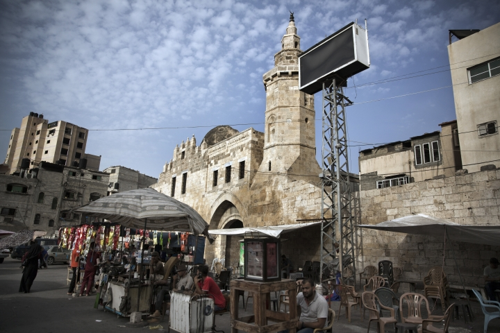 In this Wednesday July 17, 2019 photo, Palestinian vendors set up in front of the remains of the 13 century Barquq Castle, built by an Mamluk Sultan, in Khan Younis, Southern Gaza Strip. Gaza was a major trade route between Egypt and the Levant for thousands of years, but decades of uprisings, war and political turmoil have inflicted a heavy toll on its rich archaeological heritage, exposing it to looting and destruction. Neglect by Hamas authorities and a blockade imposed by Israel and Egypt have hindered efforts to preserve and protect antiquities, leaving much of the work to private collectors. (AP Photo/Khalil Hamra)