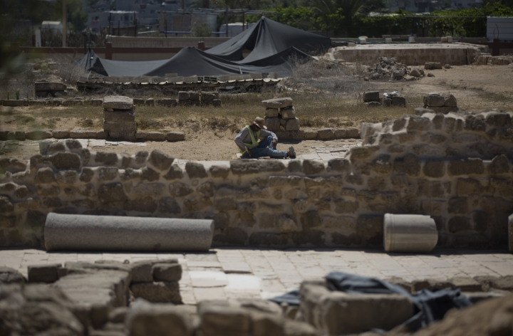 In this Sunday July 14, 2019 photo, Palestinians work on a 4th century AD St. Hilarion monastery archaeological site in central Gaza Strip. Gaza was a major trade route between Egypt and the Levant for thousands of years, but decades of uprisings, war and political turmoil have inflicted a heavy toll on its rich archaeological heritage, exposing it to looting and destruction. Neglect by Hamas authorities and a blockade imposed by Israel and Egypt have hindered efforts to preserve and protect antiquities, leaving much of the work to private collectors. (AP Photo/Khalil Hamra)