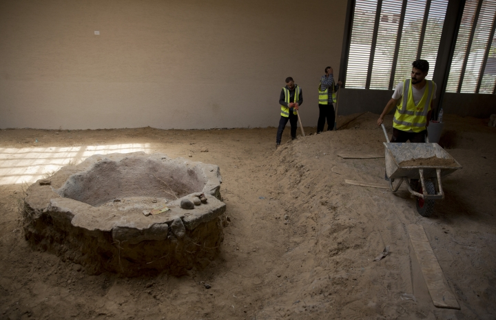 In this July 16, 2019 photo, Palestinians work on the preservation of a Byzantine period monastery near Jebaliya refugee camp, northern Gaza Strip. Gaza was a major trade route between Egypt and the Levant for thousands of years, but decades of uprisings, war and political turmoil have inflicted a heavy toll on its rich archaeological heritage, exposing it to looting and destruction. Neglect by Hamas authorities and a blockade imposed by Israel and Egypt have hindered efforts to preserve and protect antiquities, leaving much of the work to private collectors. (AP Photo/Khalil Hamra)